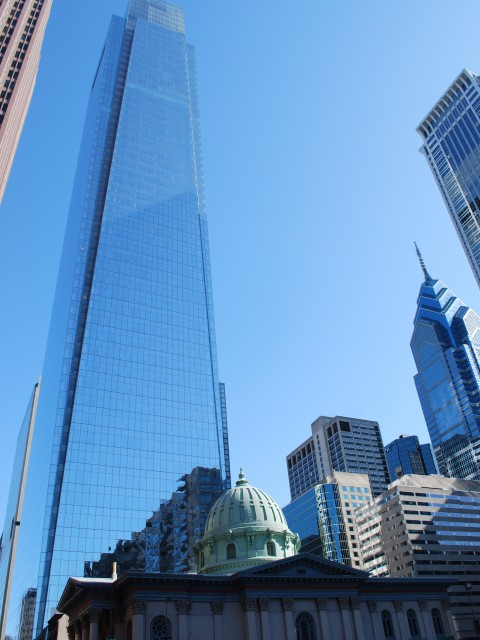 Comcast towers over a church