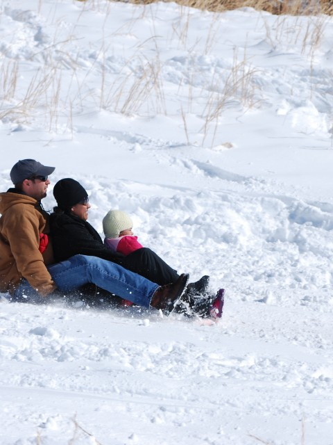 Family Goes Sledding
