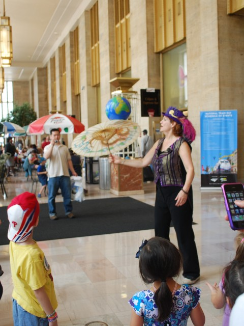 Children Gather on National Train Day to Watch Street Performer